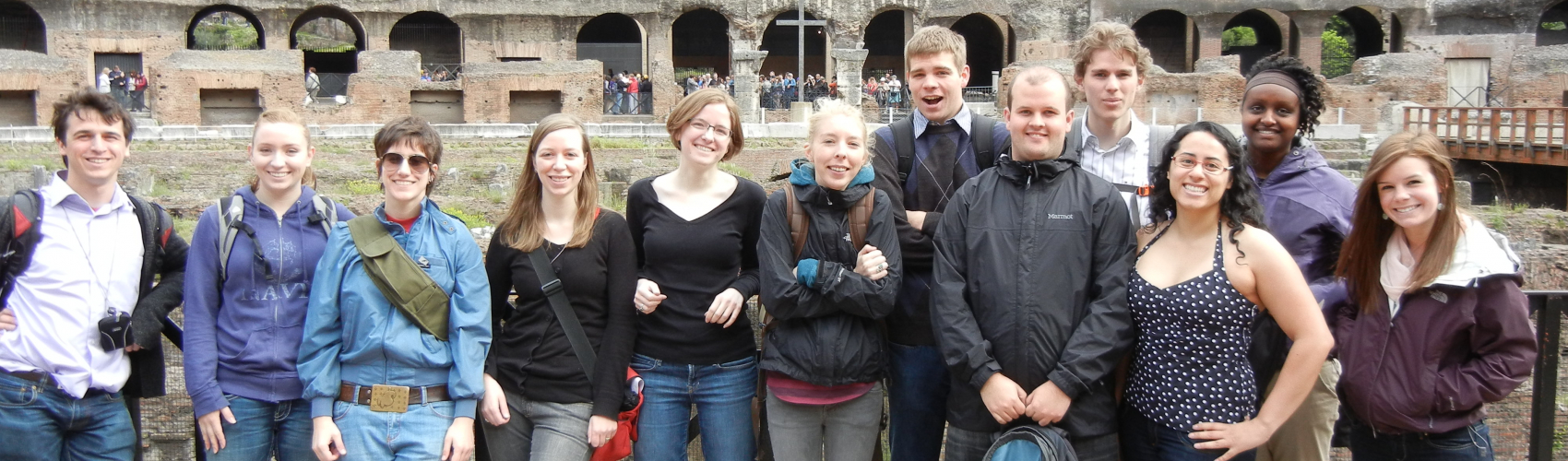 Professor Kathryn Topper and students at the Roman Colosseum