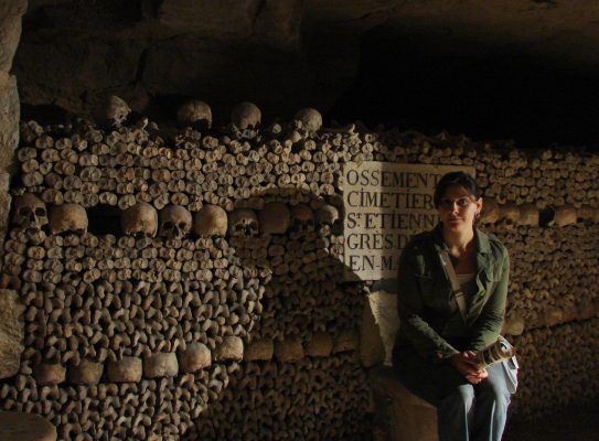Kristina Killgrove photographed in ossuary in Paris catacombs