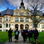 students approach Denny Hall