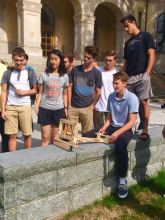 students demonstrate their model of ancient military technology