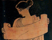 female figure reading from a scroll drawn against black background
