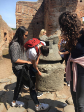 students explore a an ancient bakery in Pompeii