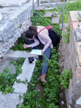 student at ostia transcribing an inscription