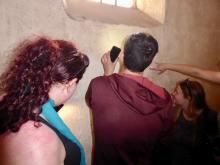 students reading graffiti at Pompeii