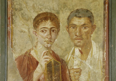 Portraits of a female and a male standing next to each other, the female holding a writing tablet and the male holding a scroll
