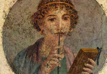 Female figure from a Classical art piece, holding a book in one hand and writing instrument up to her lips with the other