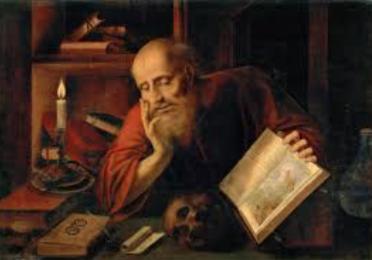 Artistic portrait of a man holding an open book