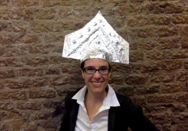 Sarah Levin-Richardson in Etruscan-style helmet