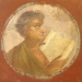 ancient fresco of young man reading